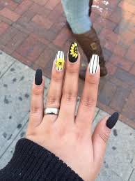 Sun Flower nail design cute strips black and white yellow.