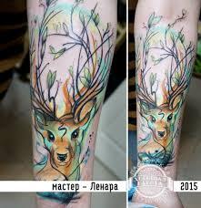 олень на предплечье в стиле акварель фото татуировок
