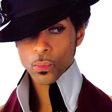 on the face makeup which included the eyeliner extending the eyebrow lip gloss and a curious dot on his cheek similar to the artist prince