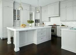 light gray paint for kitchen cabinets light gray painted kitchen cabinets with glossy white chevron tiles