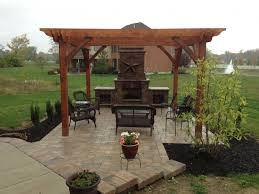 paver patio with pergola bar pergola and outdoor fireplace in centerville oh two brothers brick paving davenport project pergola fireplace kitchen in
