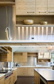Stainless steel covers the backsplash areas of these kitchen walls to  create a clean and modern look.