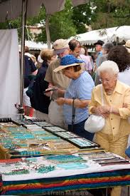 people at jewelry stand indian market santa fe new mexico usa