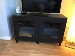 ikea besta tv stand with glass doors table entertainment center intended for tv cabinet