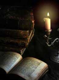 old books and candle spaxia dreamstime