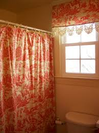 orange shower curtain color with matching window curtain for very small bathroom