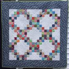 Blogger's Quilt Festival ~ Little Sister Quilt | KatyQuilts & I used some leftover blocks from a larger quilt that I made for my older  sister that can be seen here. Adamdwight.com