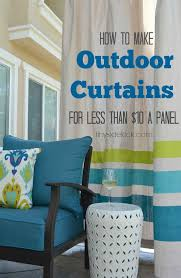 this outdoor living room is amazing and has so many smart budget friendly ideas like these outdoor curtains made from drop cloths