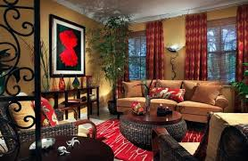 red living room decor adds so much to a room that features dark wicker and rattan
