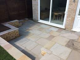 close up of the sandstone patio area by the sandstone retaining wall
