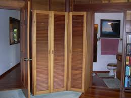 3 panel brown wooden folding louvered doors home depot for closet door idea