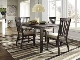 dresbar grayish brown rectangular dining room table 4 uph side chairs