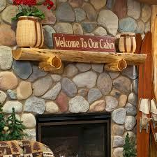 half cedar wood fireplace chimney piece with decorations a gas fireplace with river rocks wall half log cedar mantel