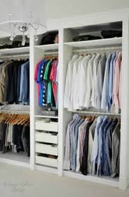 a comfy dressing room done with ikea pax wardrobes looks custom built