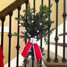 Christmas Stairs Decoration Ideas. Instead of swags of greenery trailing  down the banister, try these evergreen bunches. Use