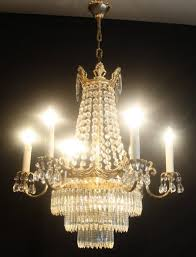 vintage empire style chandelier circular brass framed chandelier with chains of octagons forming a tent of glass and three tiers of faceted icicle drops at