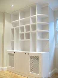 bespoke shelves hand painted white with random squares