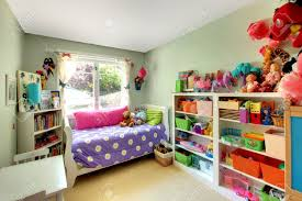 Pink And Green Walls In A Bedroom Kids Bedroom With Green Walls And Purple Bed And May Toys Stock