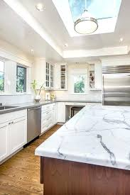 light grey quartz countertops grey quartz white kitchen wood floor hanging light window glass cabinet shelves