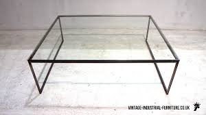 glass top coffee table with metal base pedrera