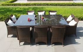 outdoor dining table set sale. dark brown wicker dining set with chairs having white cushions also rectangle table glass top placed on the gray floor - atlanta online magazine outdoor sale b
