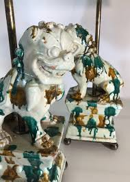 pair of medium green and cream c1880 chinese ceramic foo dog lamps on antique brass bases