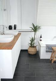 grey floor tiles our new bathroom i like the combination of cold elements white walls and grey floor tiles