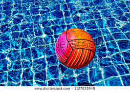 beach ball in pool. Ball In A Pool. Red And Pink Beach Floating On Water Pool