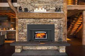 woodburning stove in stone fireplace