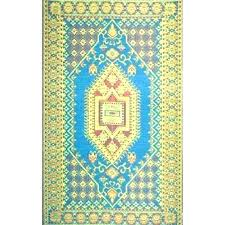 plastic under area rug recycled lemon and apple green outdoor mat medium size of living rugs