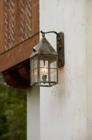 exterior lantern lighting. tudor style wall lantern hangs from the side of house exterior lighting