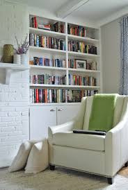 decoration: Chic White Themed Small Home Library Which Is Furnished With  Modern Sofa Colored In