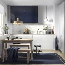 ikea ringhult drawers and jÄrsta glossy black blue kitchen cabinet fronts help create a modern kitchen