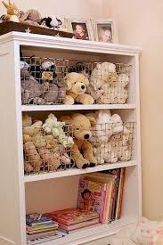 stuffed animals stored in wire bins on kids bookcase
