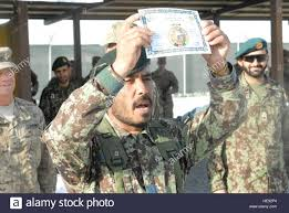 an afghan national army solider proudly displays his diploma  an afghan national army solider proudly displays his diploma during graduation ceremonies at the regional