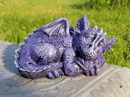 sleeping dragon garden ornament page 1