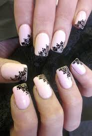 light pink nails with balck flowers accented