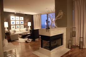 awesome modern double sided fireplace with white stone paneling on the brown laminated flooring various