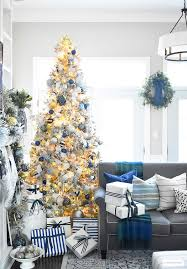 beautiful flocked tree adorned with navy light blue and elegant metallics is