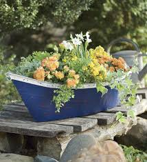 handmade recycled metal boat planter container
