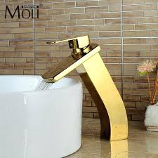 gold sink faucet luxury gold bathroom sink faucet waterfall basin mixer tap hot and cold water
