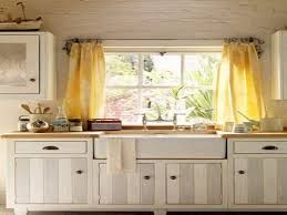 wondrous fabric double yellow curtain kitchen window ideas with white porcelain a front sink as well as white cabinet set in traditional kitchen designs
