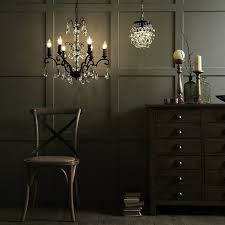 next are these beautiful glass chandeliers that cast gorgeous shadows across the ceiling are ideal for chilly wintery evenings