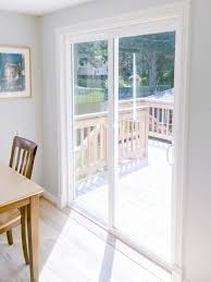 with the plinth block and door trim installed the sliding glass door now looks like