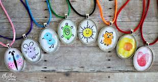 rainbow of fingerprint art necklaces children can make for pas and grandpas