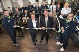 Councillor Mike Eathorne-Gibbons cuts the official ribbon with ...
