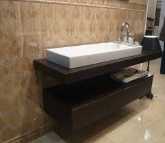 View in gallery Marble floored bathroom with gorgeous floating sink and  cabinet form