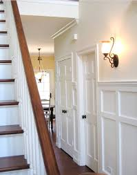bronze fixtures this is how our stairs will be white trim wood floors
