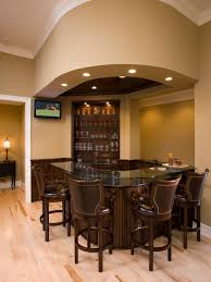 Inspiration for a timeless u-shaped light wood floor seated home bar  remodel in Minneapolis