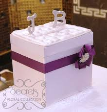 Decorated Money Box Our white satin money box embellished with purple accent and 3